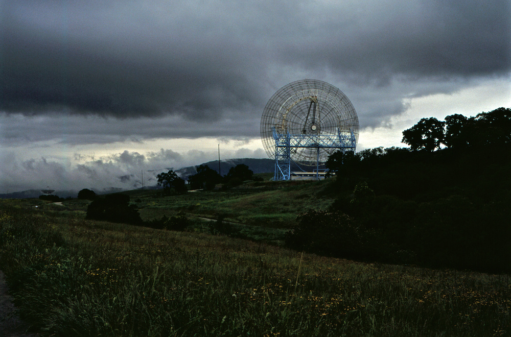 Big dish, clouds, and hills